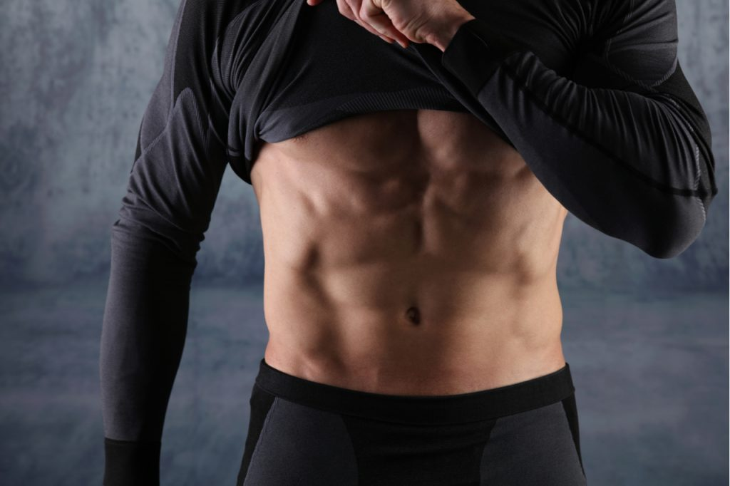 Strong athletic man muscular body with healthy tummy.