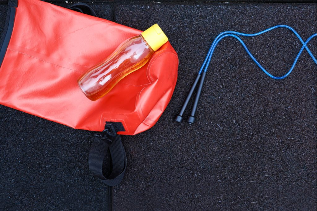 View of skipping rope on the gym bag isolated on rubber tarmac.