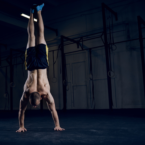 Bodyweight training, man standing on hands.