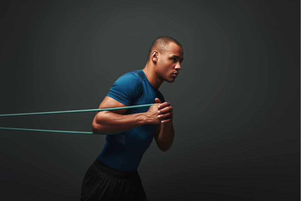 A man working out using a resistance band.
