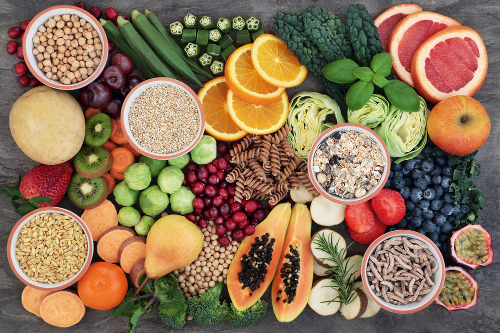 Vegan health food concept for a high fibre diet with fruit, vegetables, cereals, whole wheat pasta, grains, legumes & herbs.