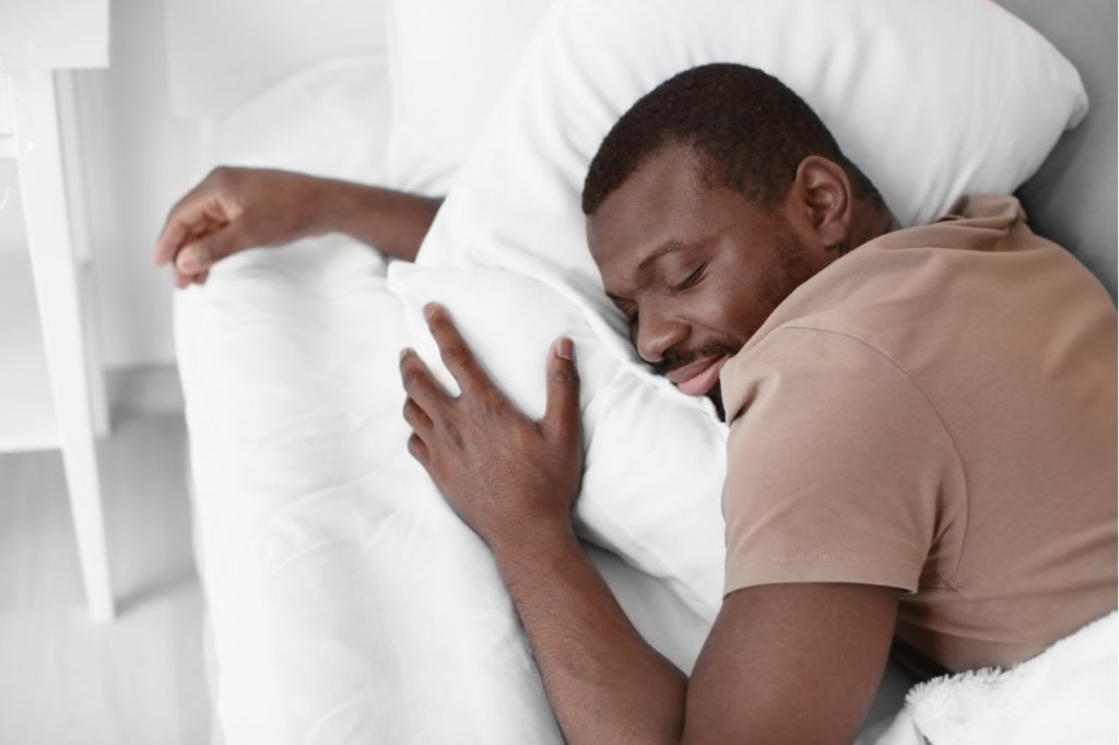 Man getting plenty of quality sleep as a first step on how to strengthen immune system.