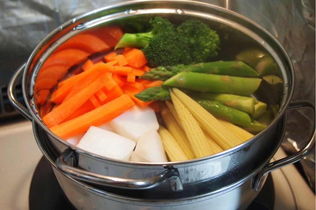 Steaming Vegetables in a pot.