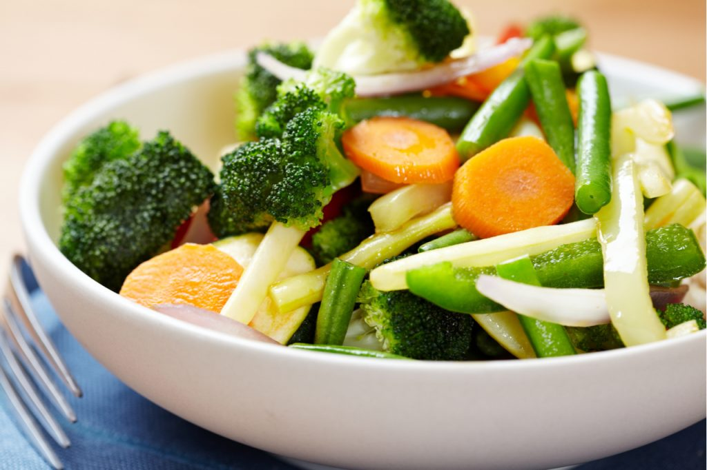 Stir-fried vegetables in a bowl. Add more vegetables in the your diet to avoid chronic diseases.