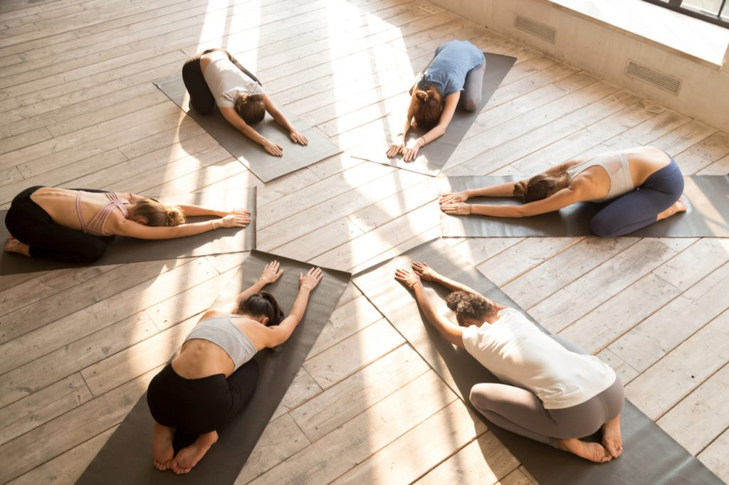 A group of woman having a yoga class.
