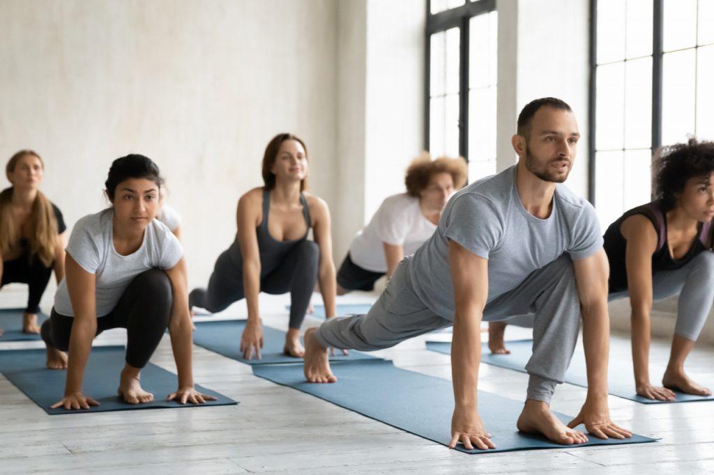 A diverse people having Vinyasa Flow Yoga Class.