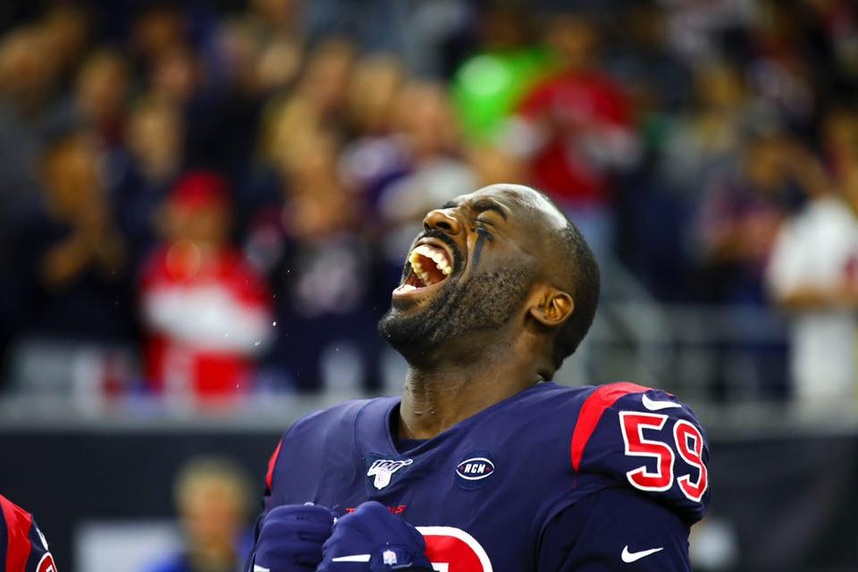 NFL Player Whitney Mercilus in a Football Stadium