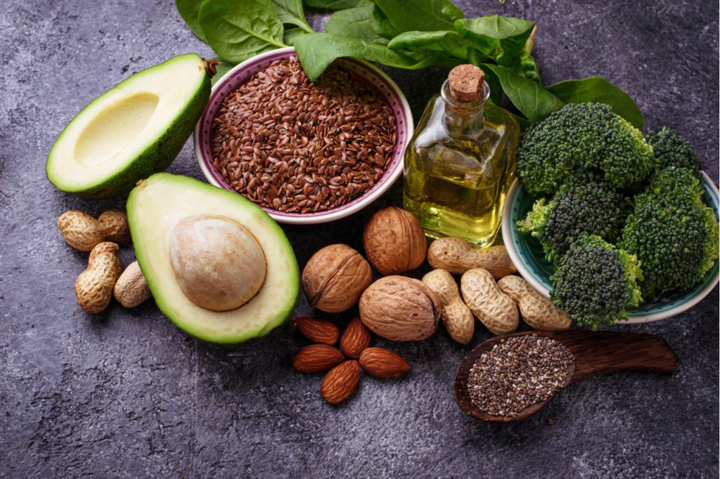 Vegan benefits of omega 3 fatty acid sources flax, spinach, broccoli, nuts, olive, oil and avocado.