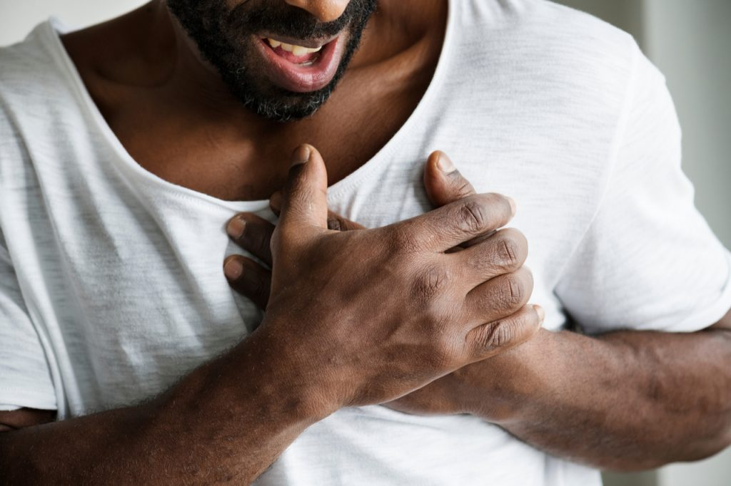 An African American man having chest pains.