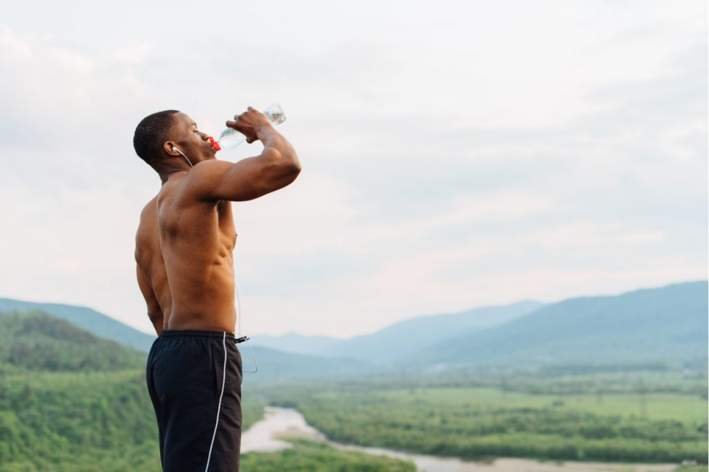 Man drinking water after sports training.