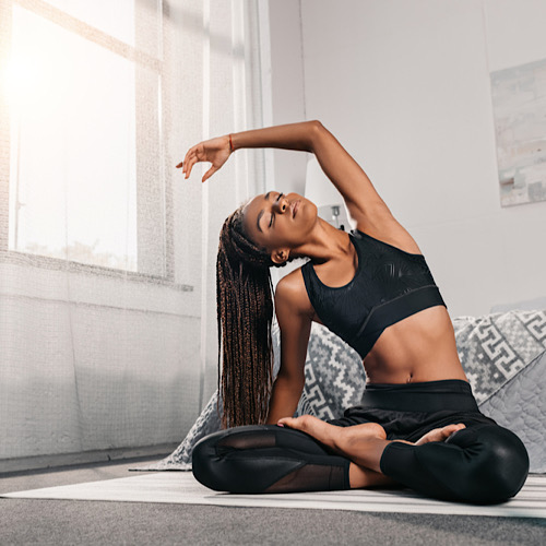 african american woman practicing yoga in side bend pose