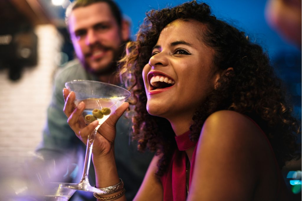 Woman having fun while drinking cocktail.