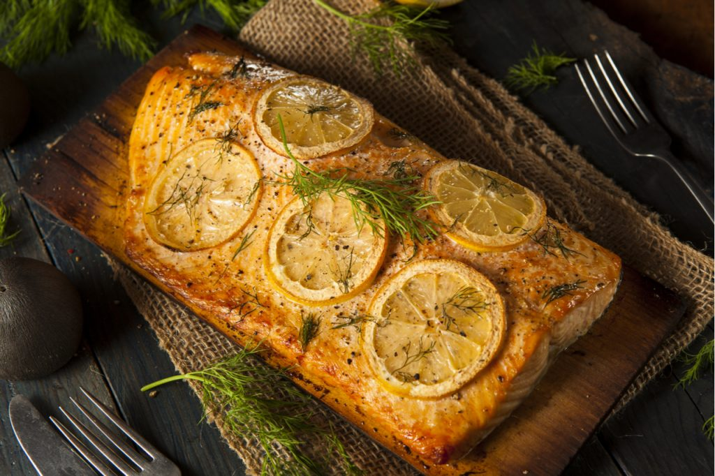 Homemade Grilled Salmon on a Cedar Plank with Dill.