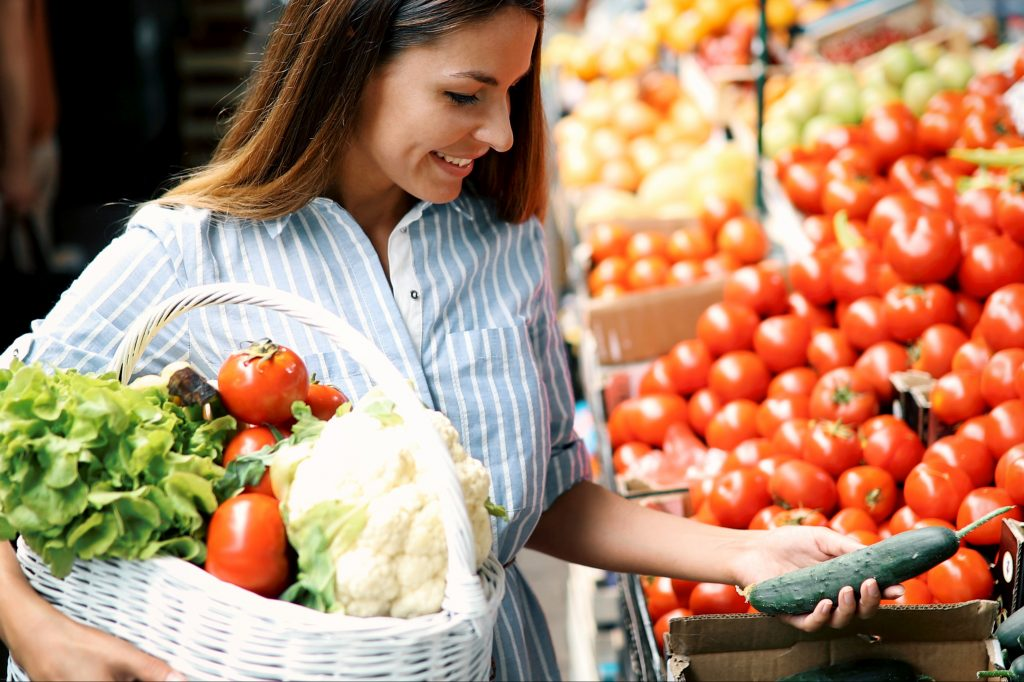 Woman shopping vegetables and fruits.