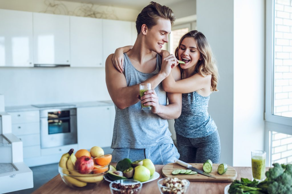 A healthy couple eating healthy foods. How to strengthen immune system?
