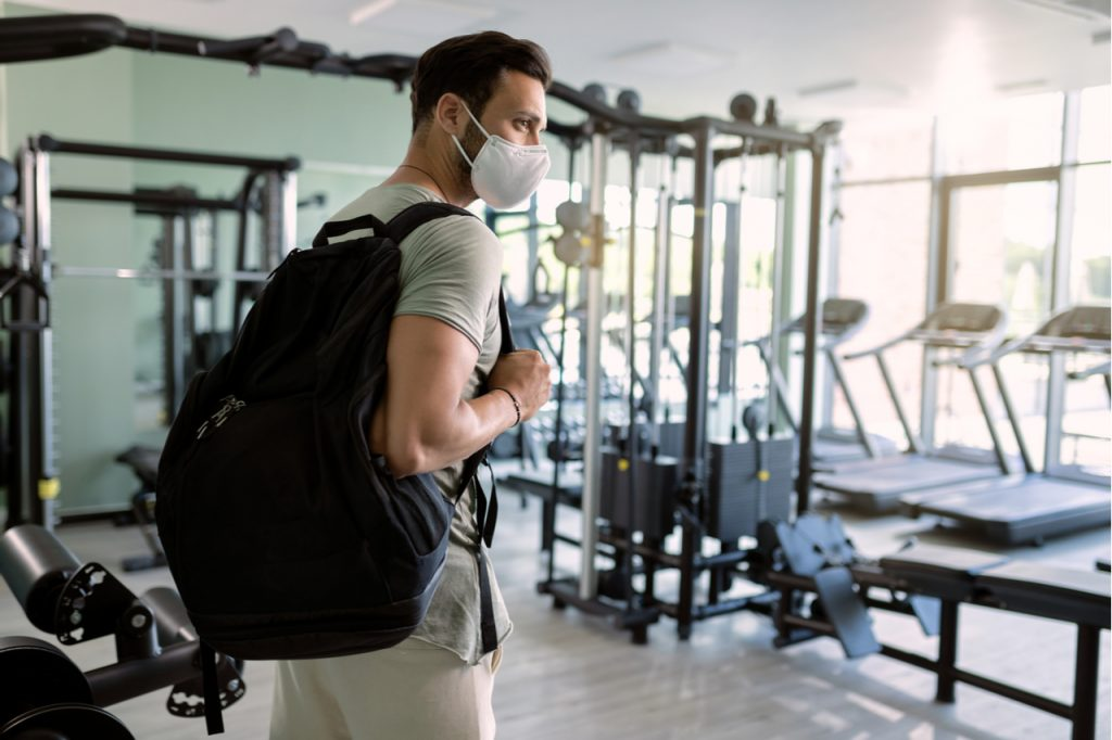 A man wearing a face mask going back to the gym after the lock down.