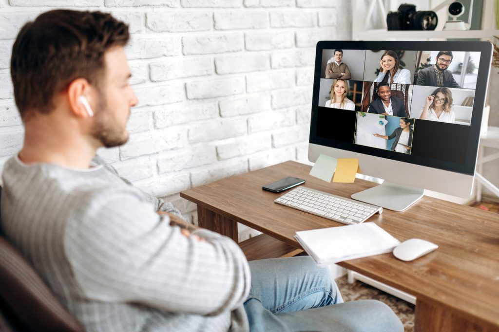 Man doing videoconferencing with a mental health support group.