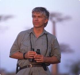 Russ Mittermeier holding binoculars.