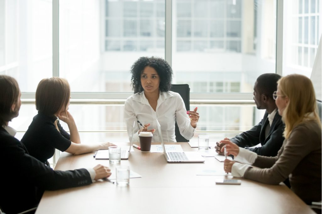 Businesswoman having a meeting with her subordinates. A female leader is a good symbol of women's equality day.