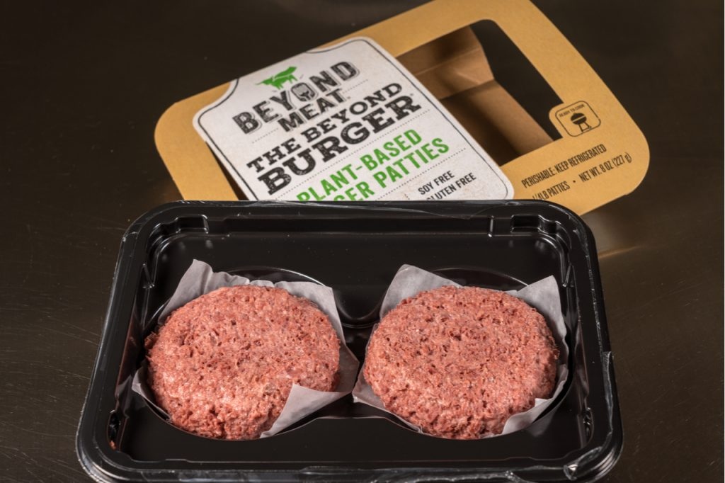 An opened box of beyond meat burger patties showing the contents of 2 burger patties inside.
