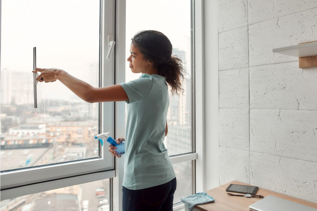 Woman cleaning window.