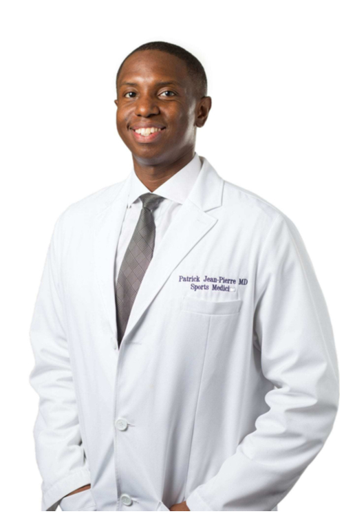 Dr. Patrick Jean-Pierre wearing his white doctor's coat.