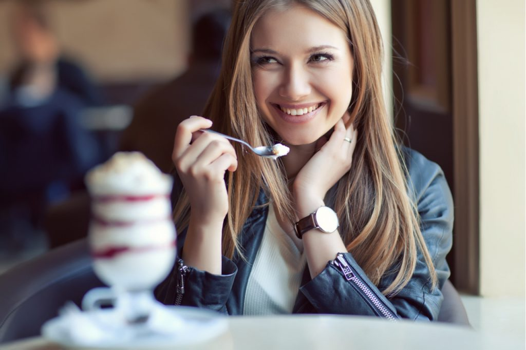 Woman eating realgood super premium mocha java chip ice cream.