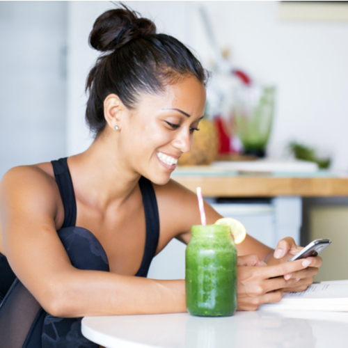 Woman drinking a homemade green detox juice