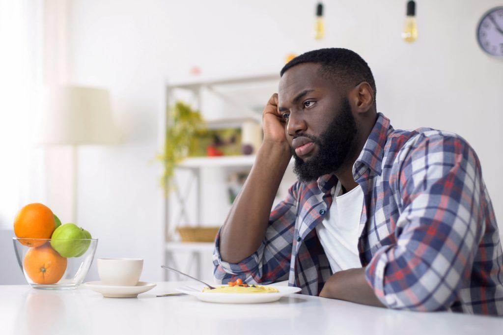 Man having no appetite, eating disorder, depression problem.
