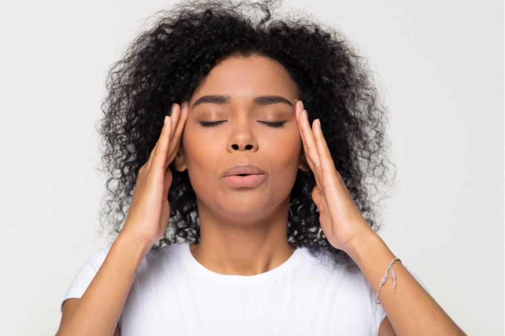 Woman breathing calming down managing stress.
