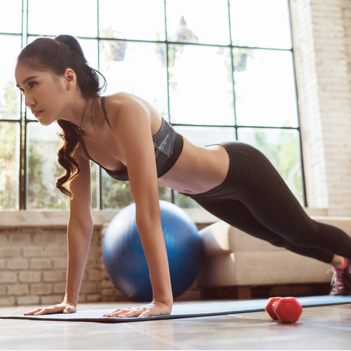 Woman doing her workout in her living room.