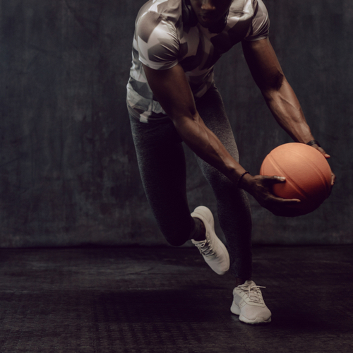 Athletic man training with a basketball.