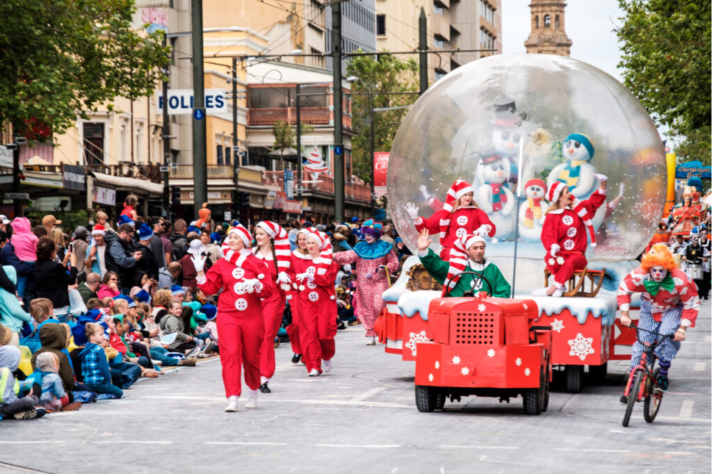 A Christmas Day para with floats, bands, dancers and clowns.