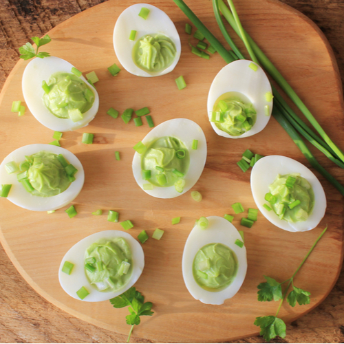 Deviled eggs appetizer with avocado.