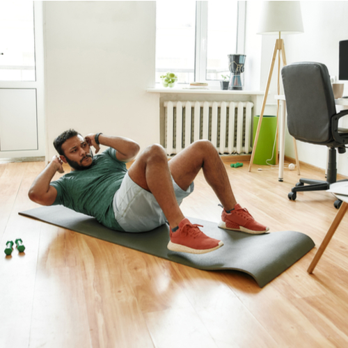 Man doing exercise while streaming.