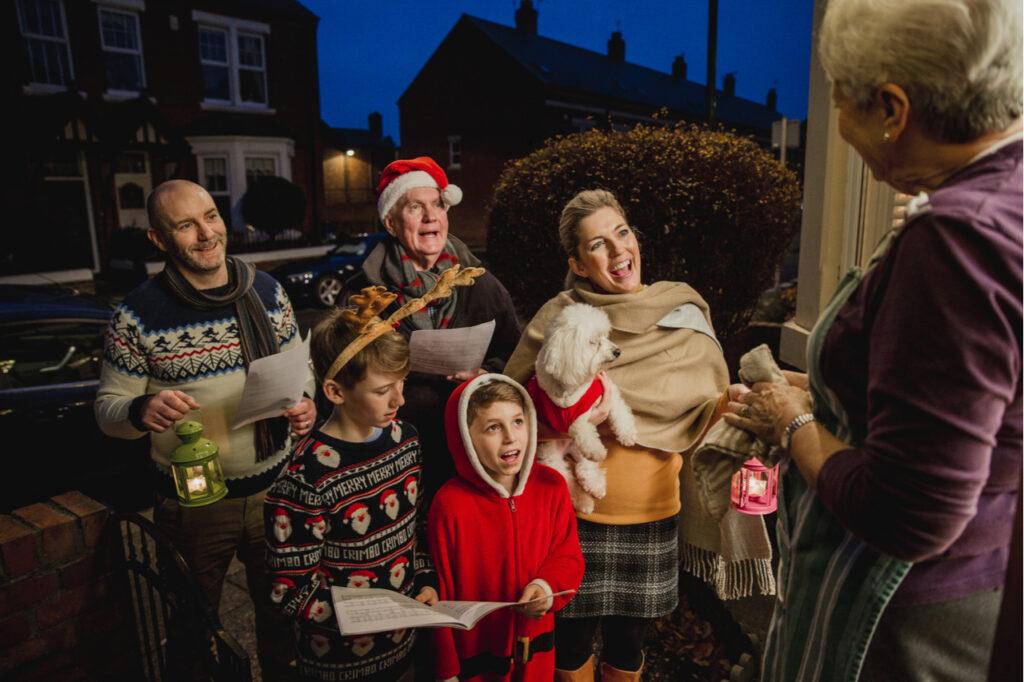 A lovely family doing door-to-door carol singing.