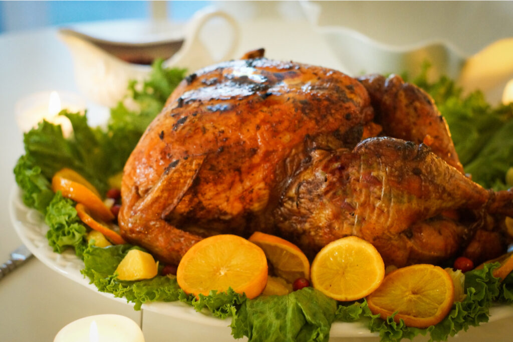 Roasted Turkey with leaves, lemons, and oranges for Christmas.