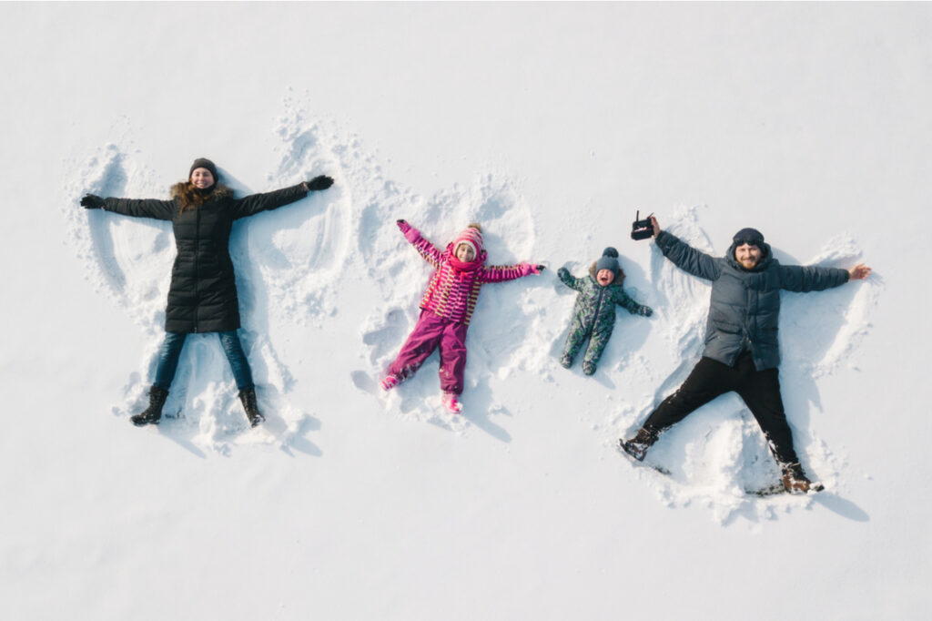 Family making a snow angel.
