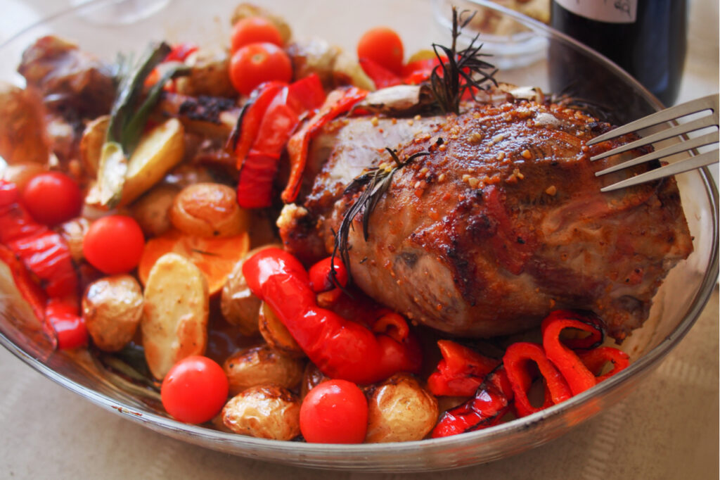 Roasted meat leg of lamb with potatoes.