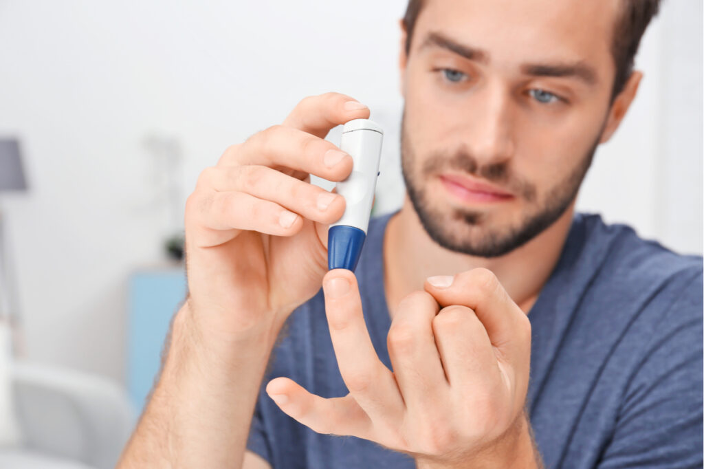 Man checks sugar level for diabetes prevention.