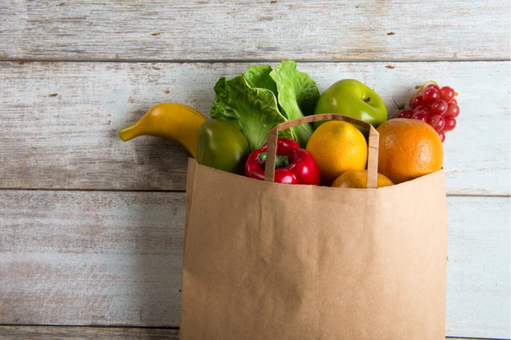 A bag full of fruits and vegetables.