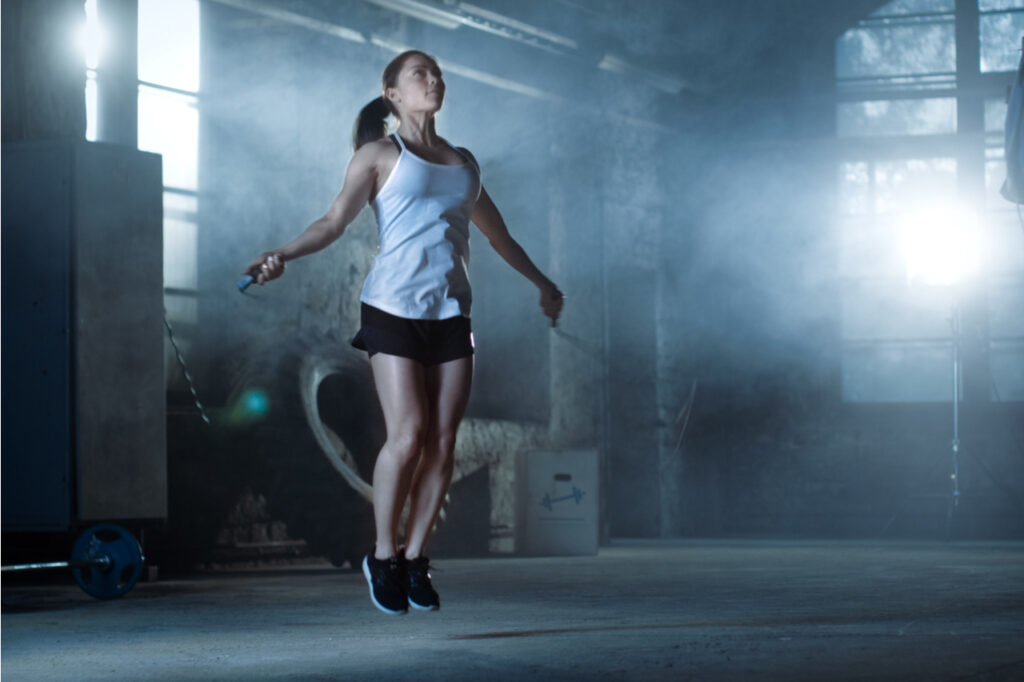 Woman working out with fitness ball.