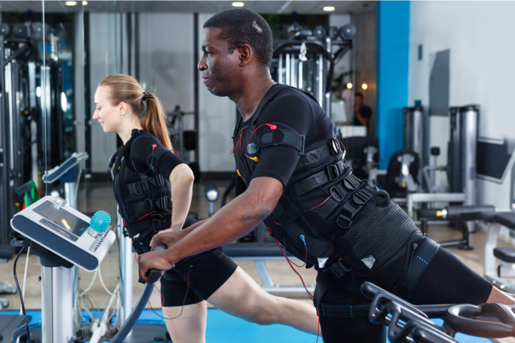 Man during EMS workout in fitness gym.