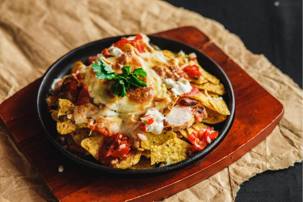 Cchicken nachos on a serving plate.