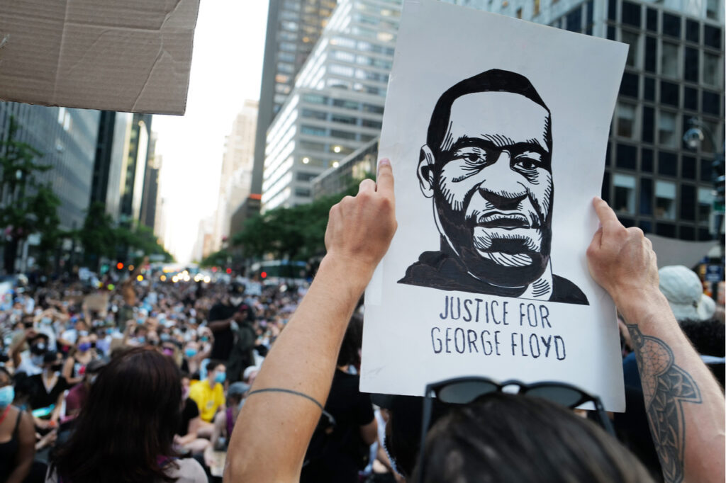 People holding a portrait of George Floyd during the Black Lives Matter Protest.