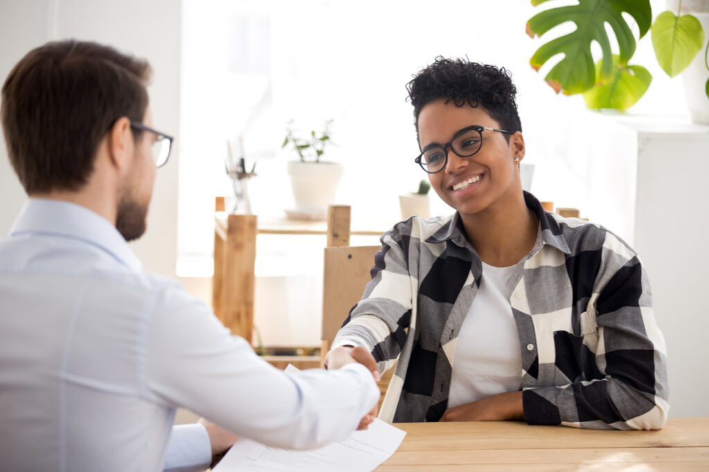 Happy confident applicant shaking hand of hr manager offer new job.