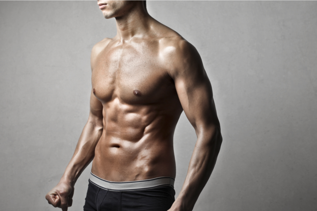 Detail of shirtless muscular man wearing saxx underwear men's ultra boxer briefs.
