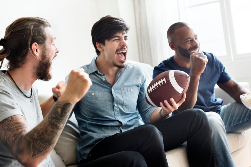 3 men cheering while watching super bowl. What are super bowl snack ideas?