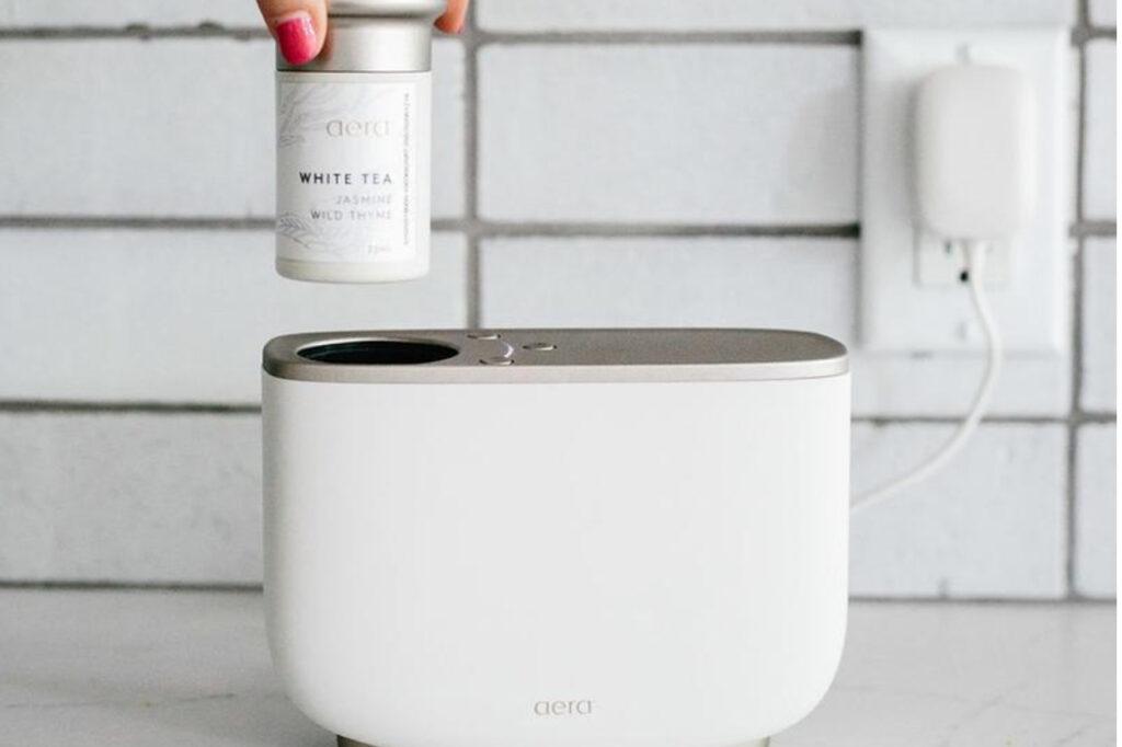 The aera diffuser and a white tea essential oil capsule.