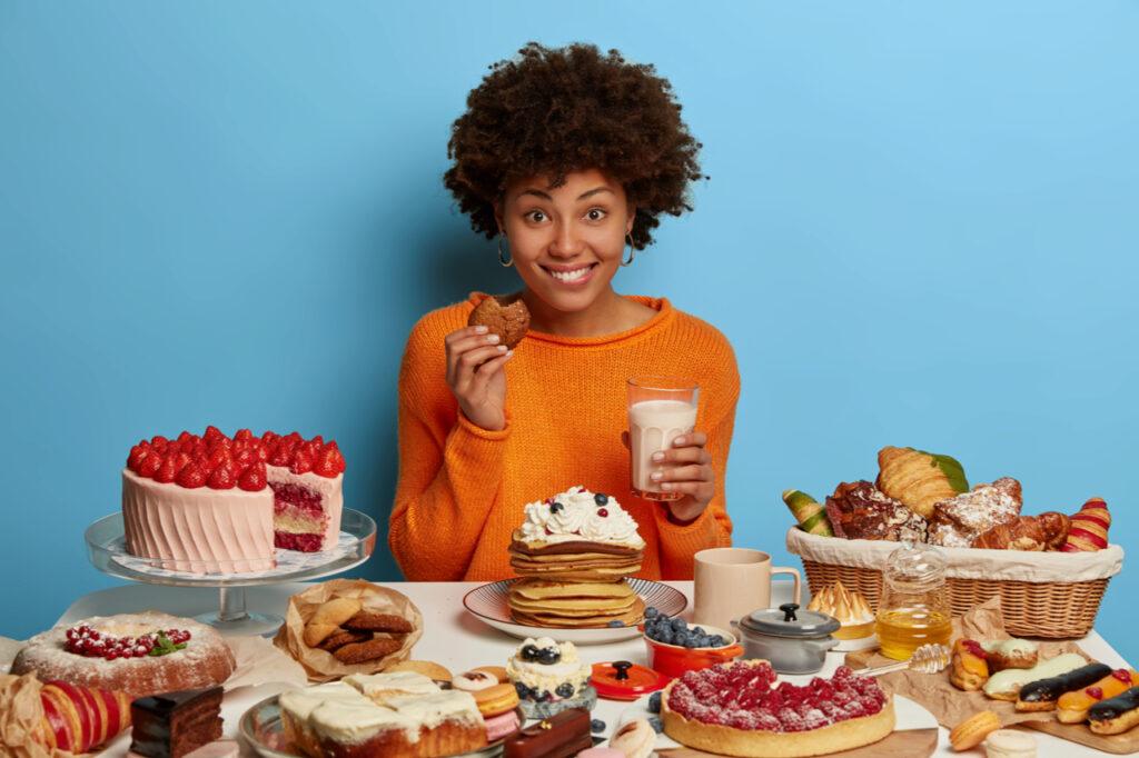 Woman enjoying sweets.